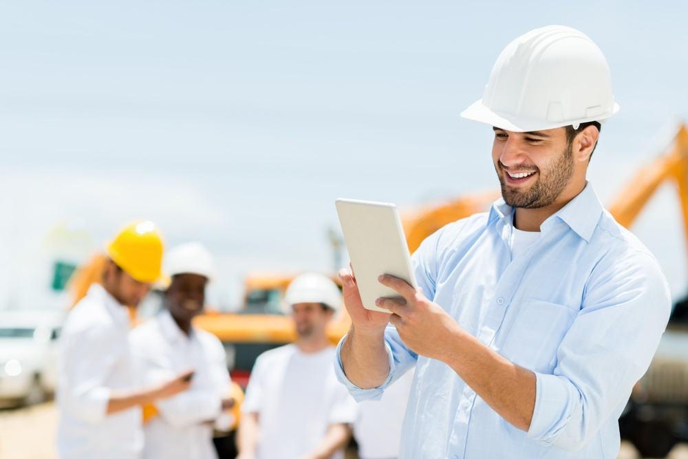 Male engineer at a construction site with a tablet computer .jpeg